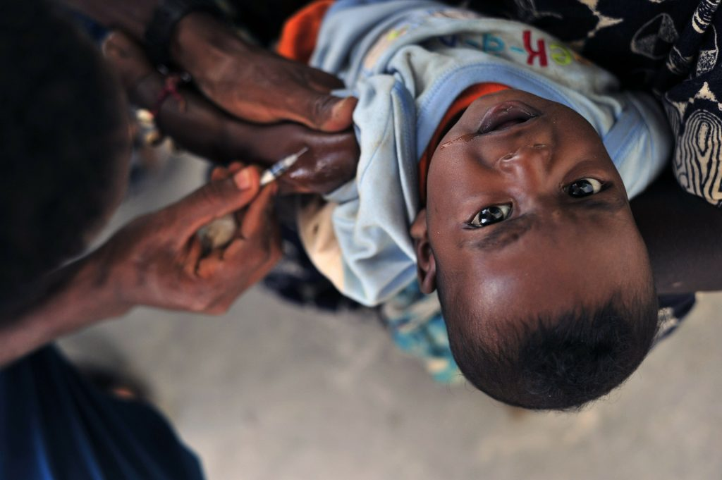 African child receiving a vaccine injection